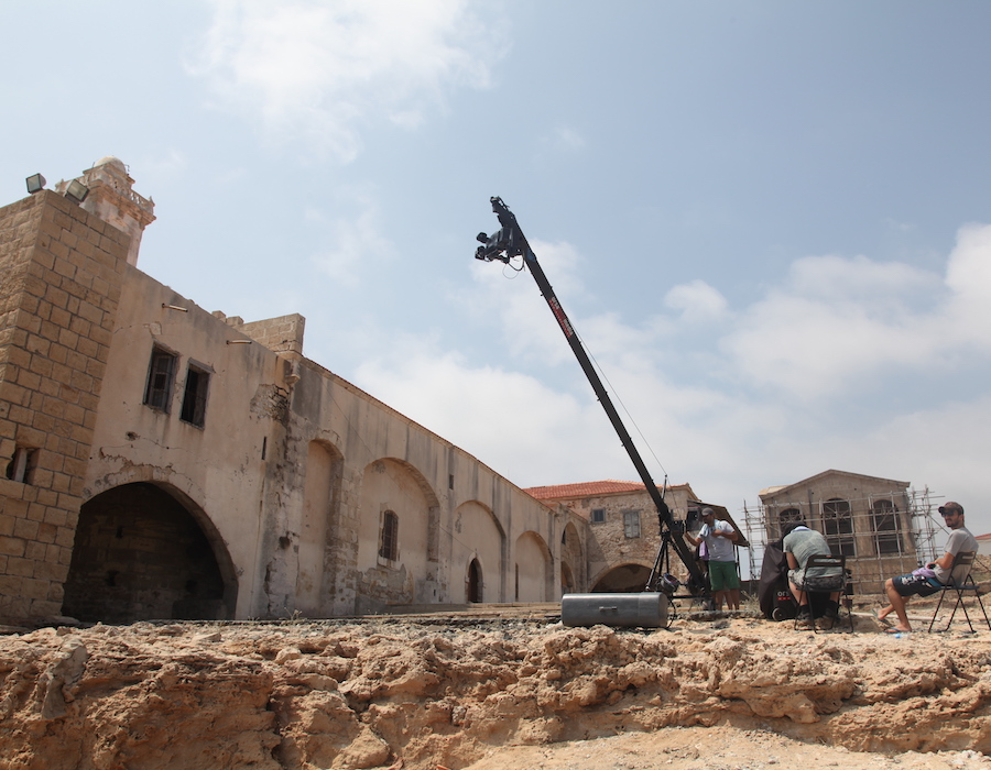 A still of a camera atop a crane filming the holy monastery of Apostolos Andreas in Cyprus.